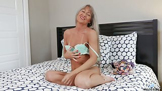 Grey haired granny Leilani Lei is toying her stretched wrinkled pussy