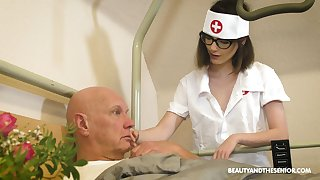 Horny nerdy nurse Sara Bell bows and provides older man with a BJ