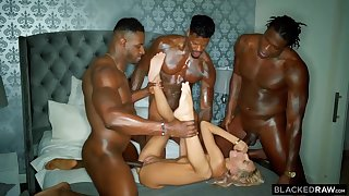 Three horny black guys are stretching one poor blonde cutie with their hard throbbing cocks