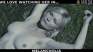 Hollywood star Kirsten Dunst flashing her big tits while lying on the grass