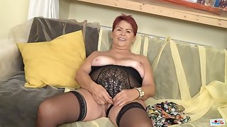 Red haired, Czech granny is wearing erotic, black lingerie and playing with a sex toy