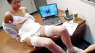 Footjob in the office with hot brunette
