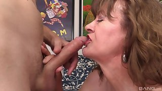Mature blonde granny Babe Morgan rides doggy and cowgirl style
